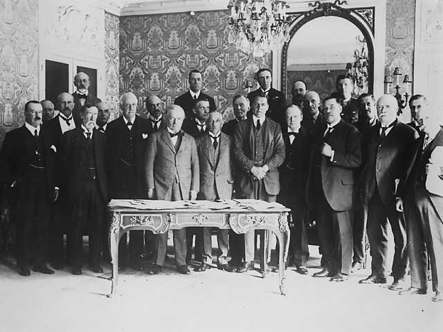 Churchill is standing in the front row, third to the right of David Lloyd George. Sir Henry Wilson is immediately behind and to the right of Churchill.