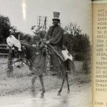 Reveller riding a donkey